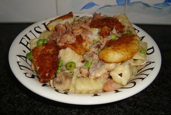 Festonati pasta of andere deegwaren met visfilets, garnalen en champignons 8