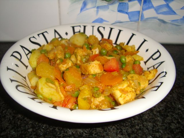 Stoofpotje van kalkoen, ananas, aardappen en groentjes 1