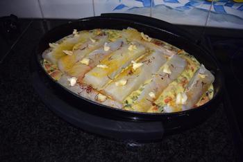 Ovenschotel van skrei of kabeljauw, mosselen, groentjes en saffraansaus. 5