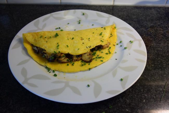 Omelet gevuld met paddenstoelen. 1